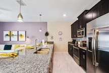 The open floor plan allows a constant flow of family togetherness and laughter. Elegant and spacious you are sure to enjoy this kitchen area.