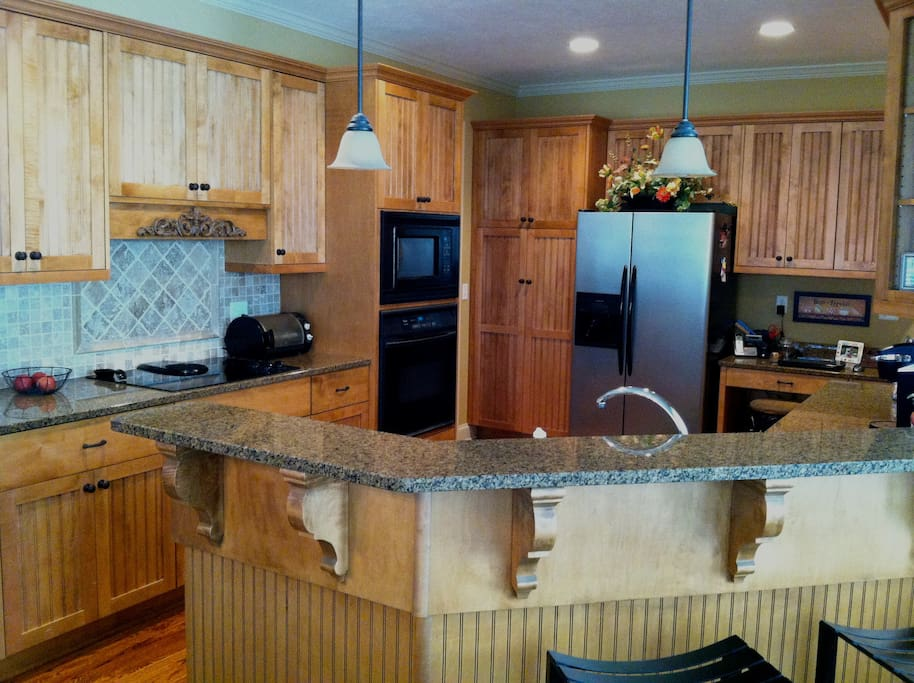 Kitchen with entrance from 3 car garage and access to laundry room-opens to breakfast area