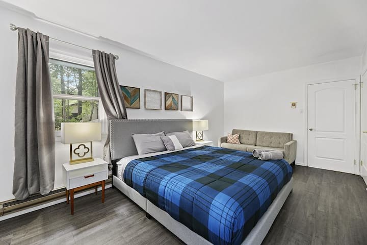 Room1: Snuggle up in this King Size Bed