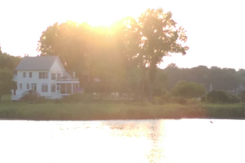 The house as seen from across the water. We are on a river and a lake.