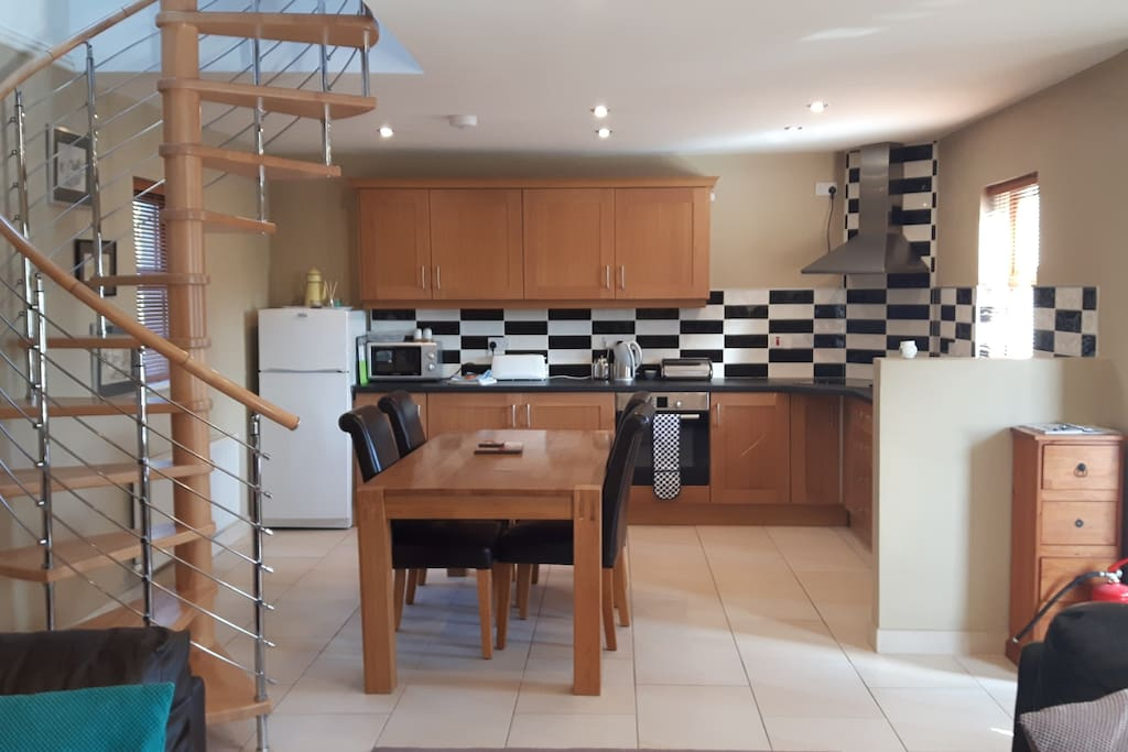 Open plan kitchen with spiral staircase