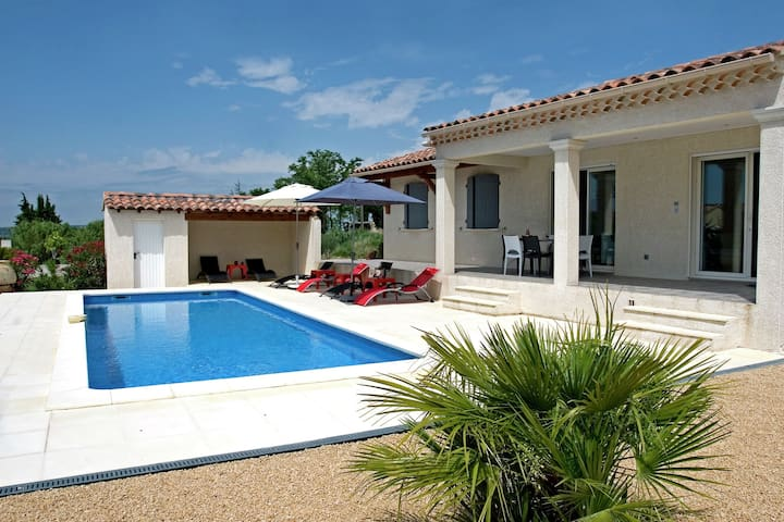 Detached villa with private pool situated in a typical Provencal landscape