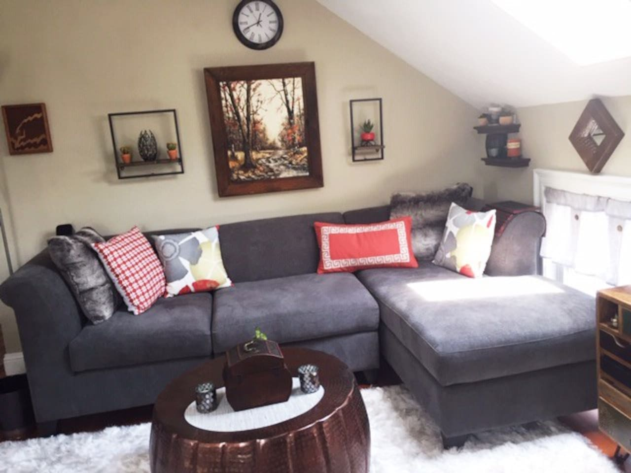 Modern, updated living room, designed by host and owner of Interior Decorating NE