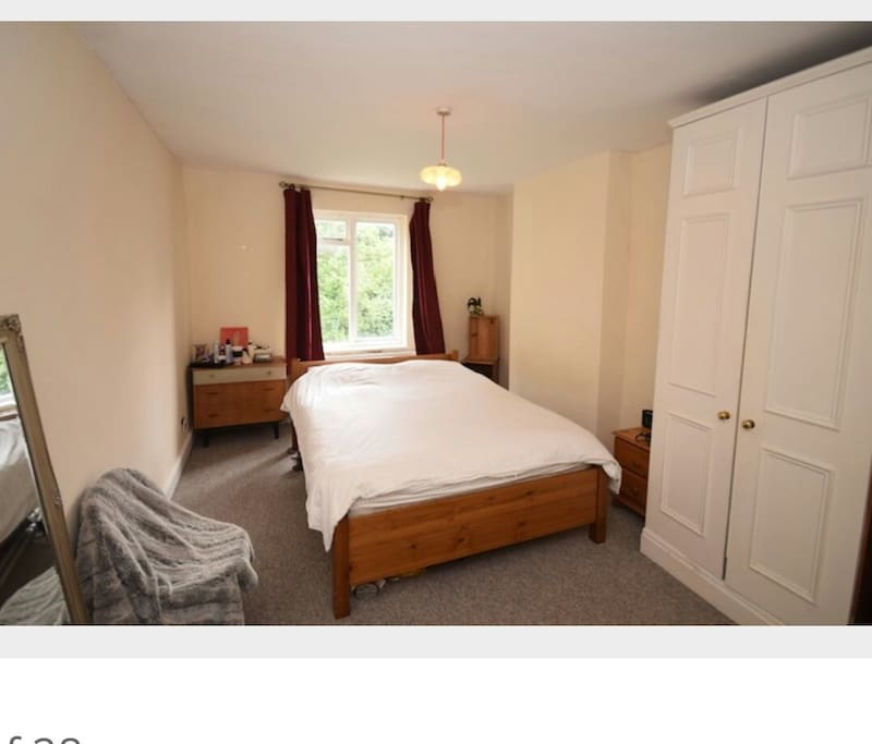 Small king sized bed, full length mirror, gplan drawers, cupboard, iron and board.