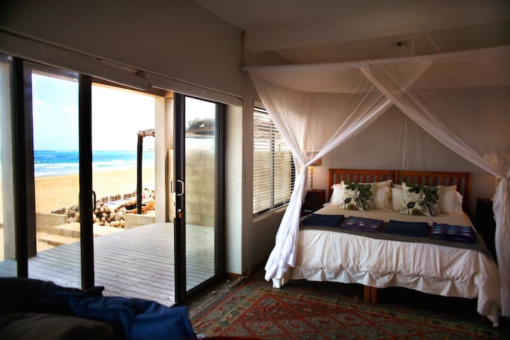 Downstairs sea facing bedroom. Step outside directly on to the beach.