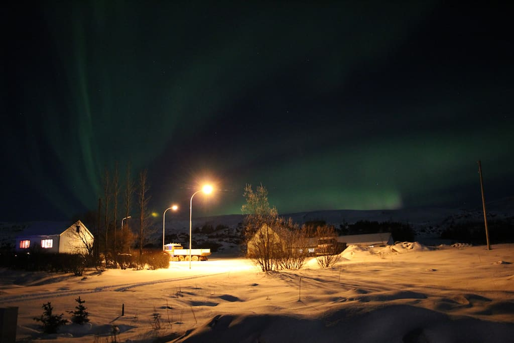 Northern lights infront of the house.