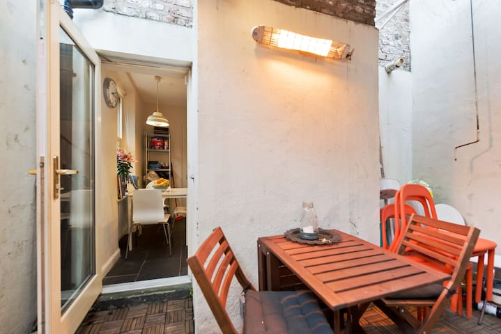 Outside seating in our little courtyard garden with outside heater