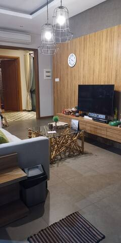 Living room with curve smart TV