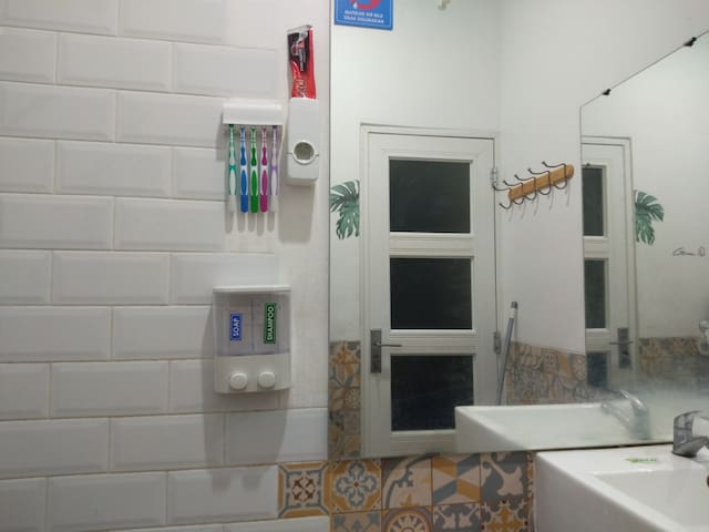 Bathroom at first and second bedroom with complete amenities