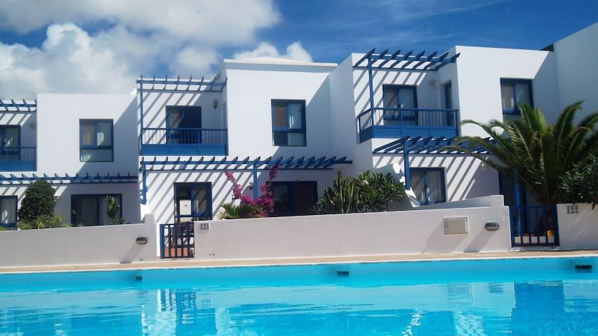 Duplex con piscina 1ª linea mar - Playa Blanca - Huis