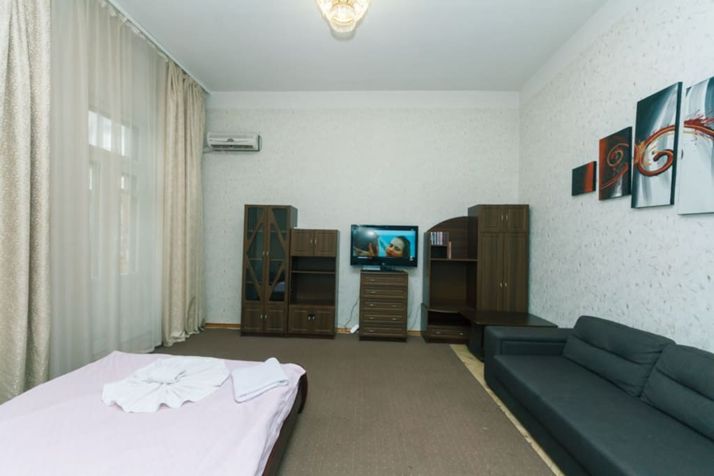 Living Room With Big Bed and Convertible Bed, AC and TV and Balcony