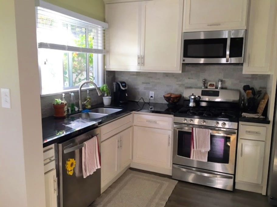 Granite countertops, stainless steel appliances