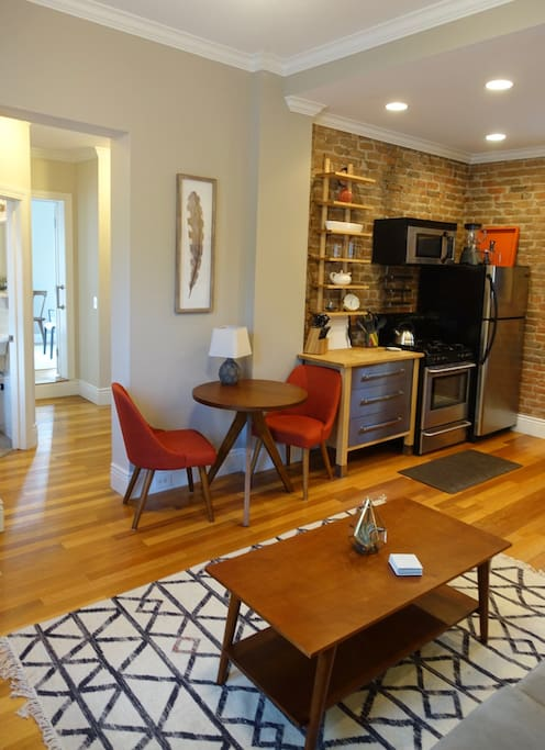 The open-plan kitchen living room features newly furnished mid-century modern elegance.
