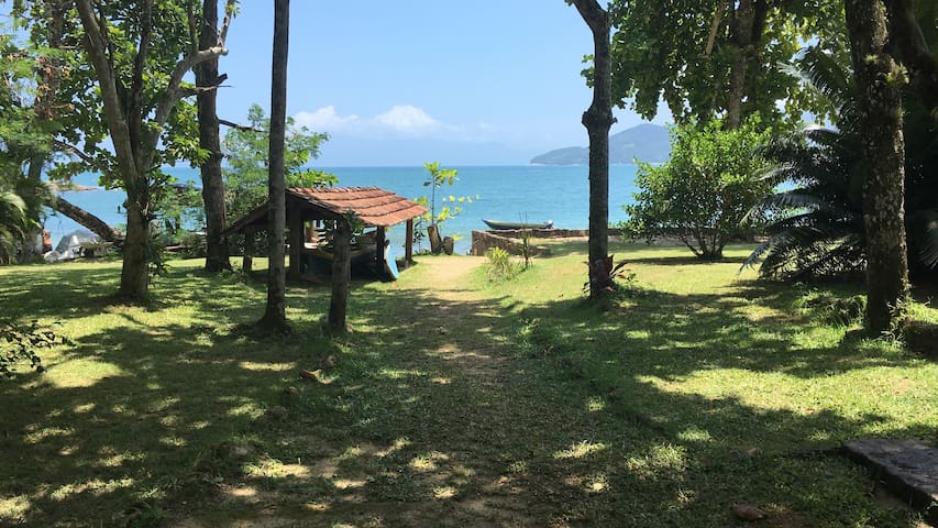 Casa pé na areia com vista ao mar