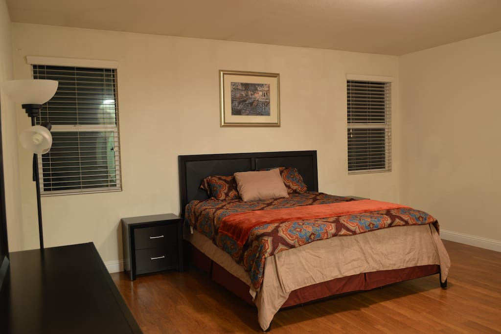 Fully furnished  bedroom with bed, storage space and nightstand provided.