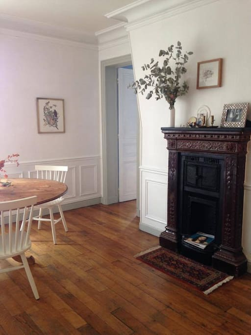 Dining area with a decorative fireplace