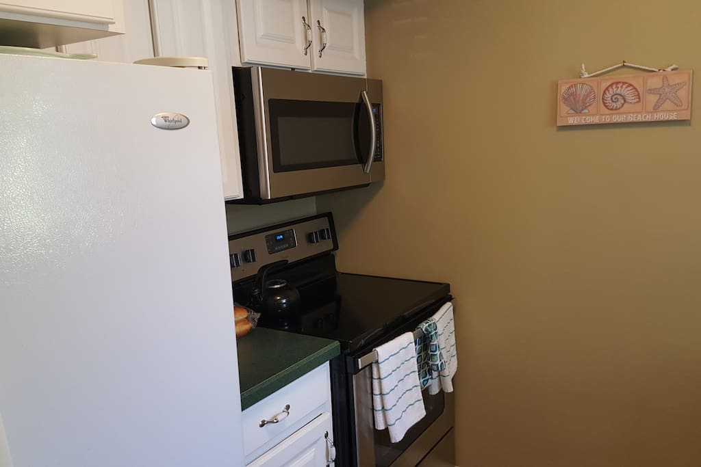 Kitchen is updated with new microwave and glass top stove