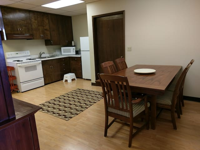 Common area with table and kitchen.