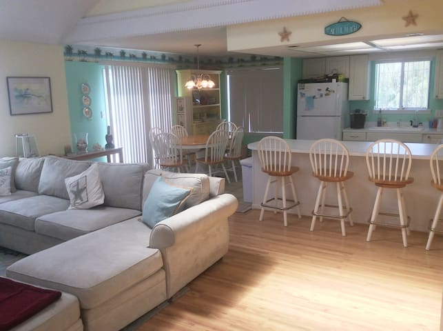 Open living area with eat-in kitchen