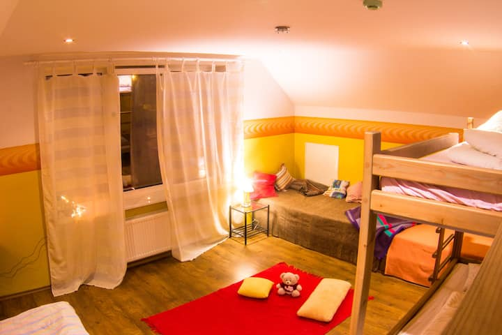 Light and cosy room for 5 persons