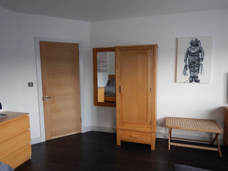 Large mirror and plenty of clothes storage