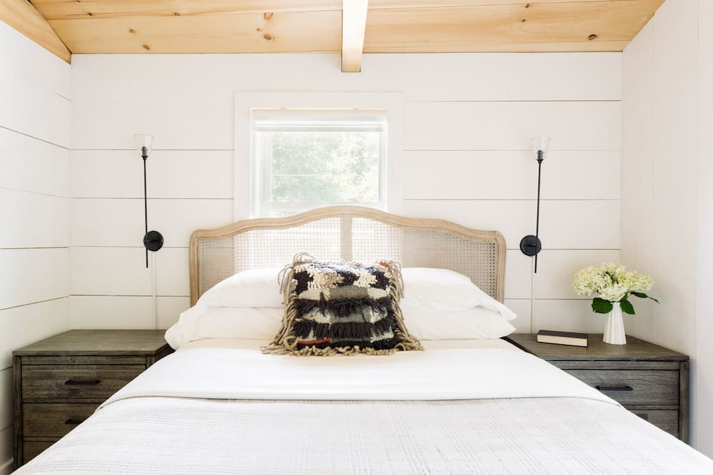 feel free to sleep in our modern French Country bed with Ship Lap walla and Restoration Hardware Sconces.