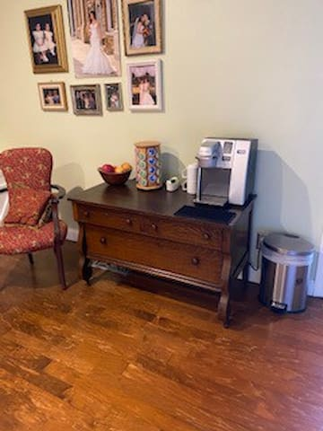 Keurig with assortment of coffee, tea and muffins