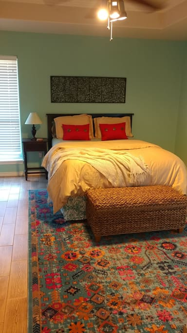 Master bedroom with queen. A crib will also fit in this room if you're traveling with littles.