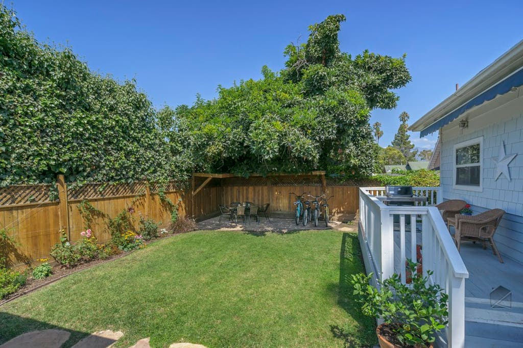 Spend some quiet time in this tranquil backyard space. It features a deck with gas grill, a table and six chairs, and a lovely garden and lawn space.