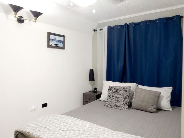 The bedroom has large windows, ceiling fan and air conditioning for added comfort.  This Queen sized bed comfortably sleeps 2 persons.