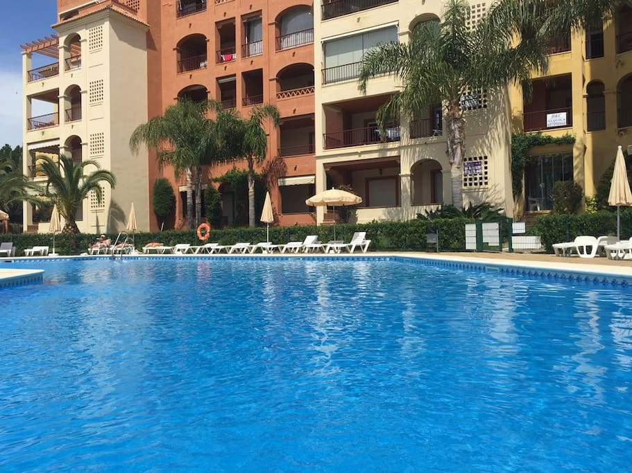 Our own communal pool area is a delight! Lots of umbrellas and sun beds to use.