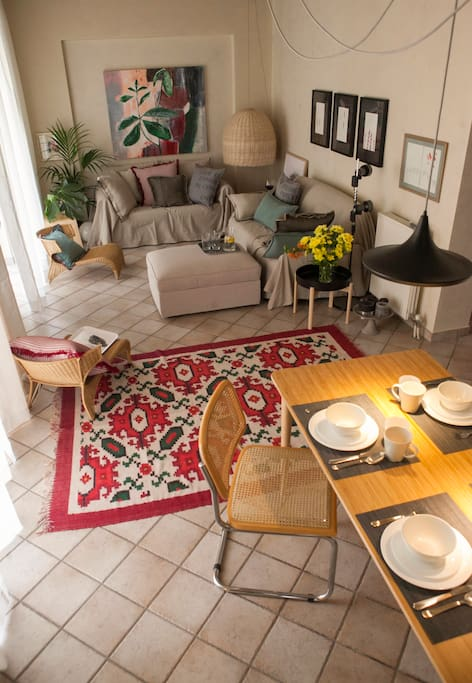Living room and dining table are decorated in a relaxed, laid back style.
