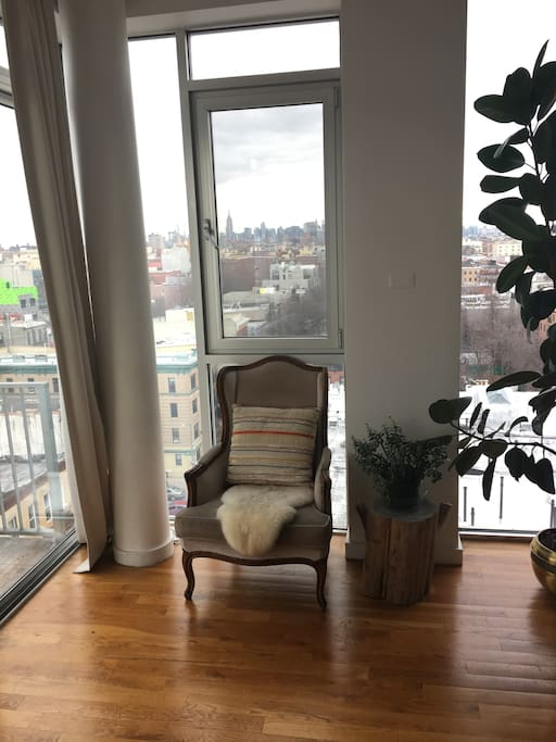 Reading nook in the living room with NYC skyline view.