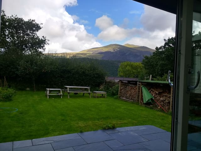 The open plan kitchen/dining room has great views of Snowdonia