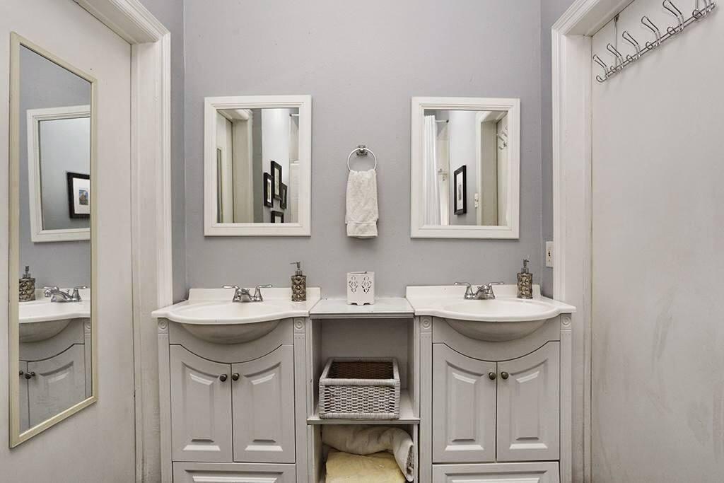Double vanity in large bathroom.