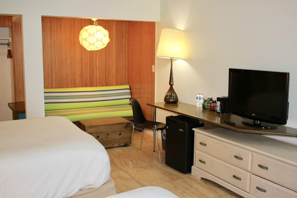 Queen size beds, TV set
