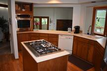 Kitchen facilitates socializing with chef and guests.