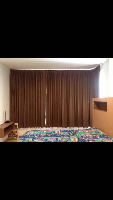 Double bedroom with blind curtains.