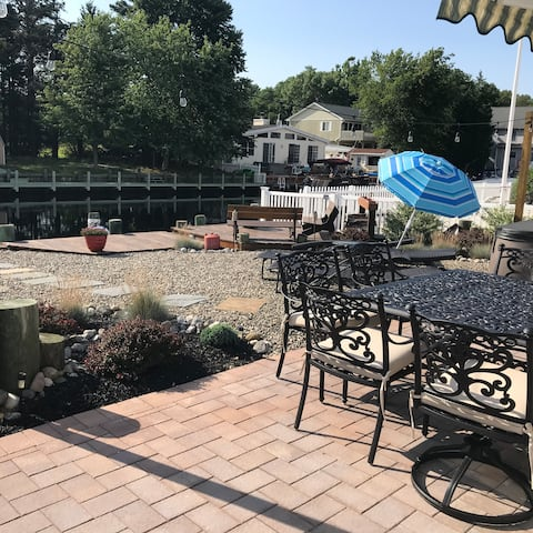 Table for 8, dock, AMAZING SUNSETS, patio fire pit and lounge chairs for 5 people.  Beach passes included- just bring your flip flops
