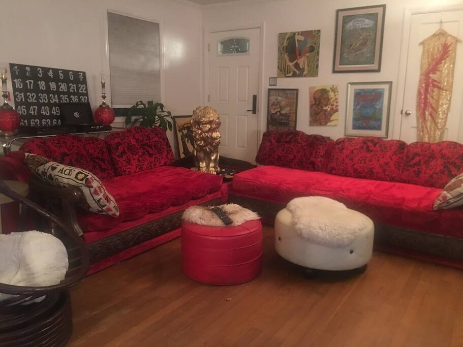 Groovy living space with vintage furniture, tv, and turntable.