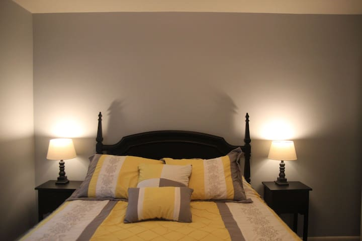 2nd bedroom with a queen bed, dresser, and closet!