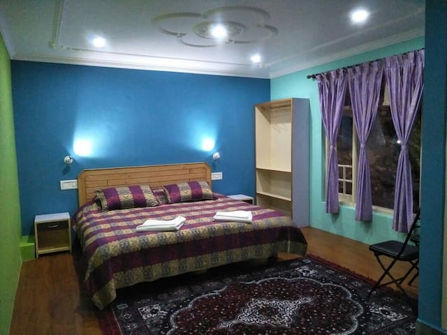 Deluxe village room above Bhagsu and McLeodganj
