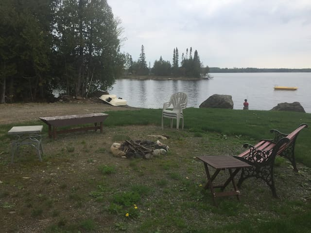 Guests will have full access to the fire pit and yard including the swim raft, paddle boat, dock, and deck looking out onto the water.