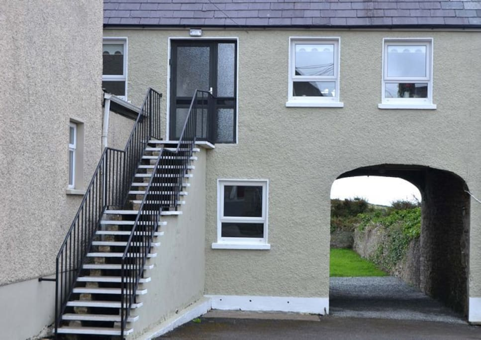 Up steps to entrance to 2bed Apartment