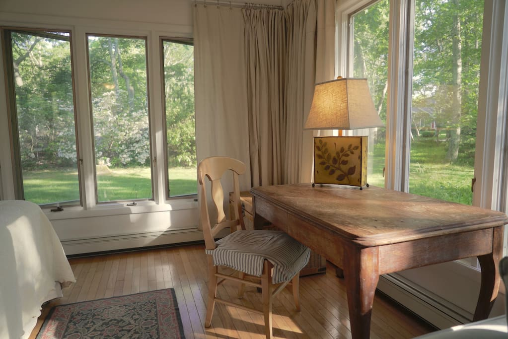 Corner Desk or Dining Table & Curtains that close all windows for sleeping in