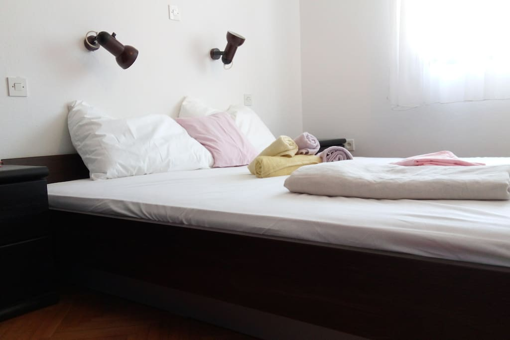 Master bedroom (king size bed), with a large closet for storing and hanging clothes and luggage.
