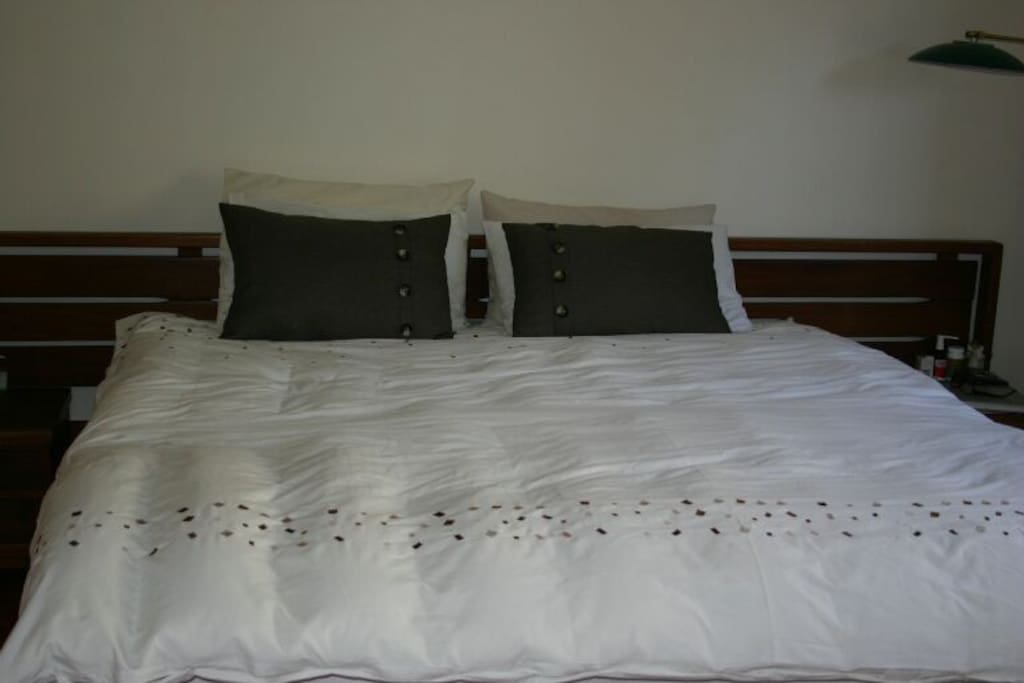 A comfy queen size bed and a sleeper couch are available in the flatlet.