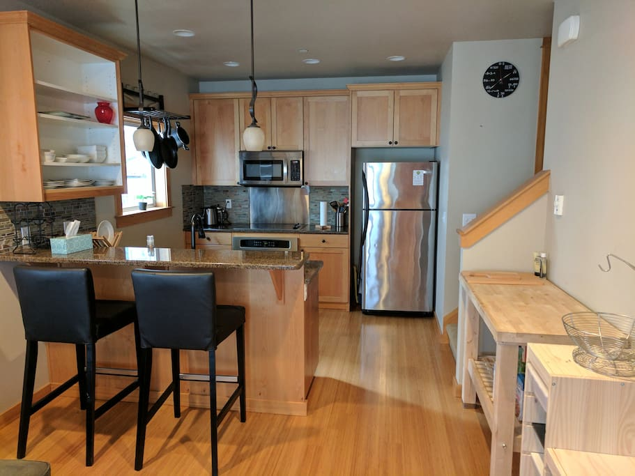 The second floor has  a kitchen, dining/living space, and half bath.