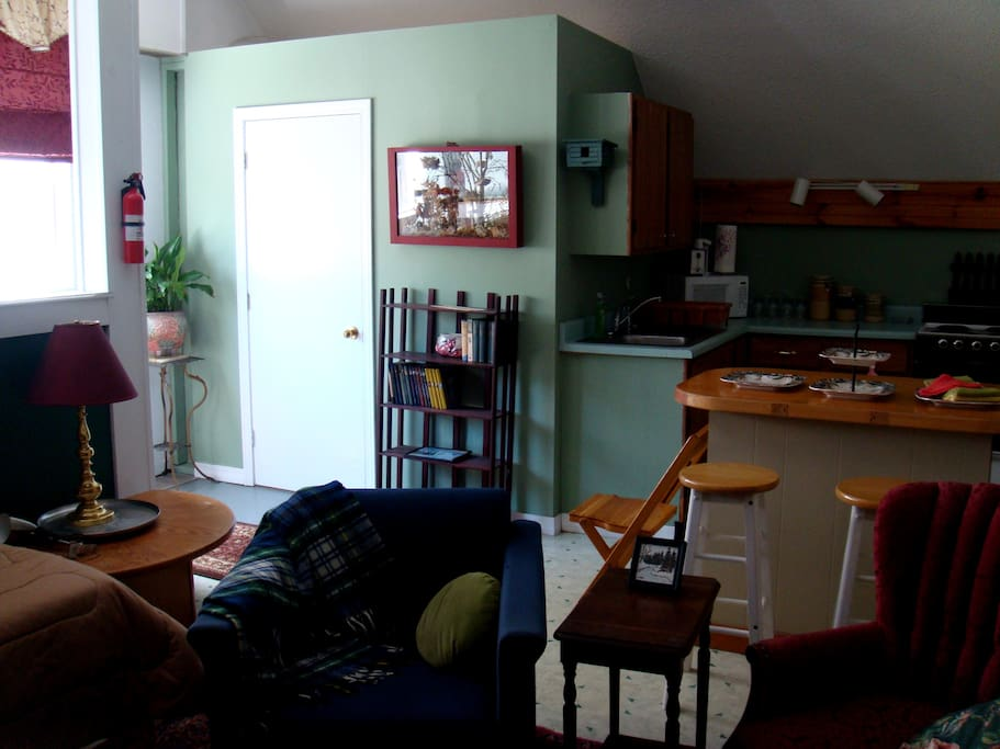 Looking from LR into landing and kitchen.