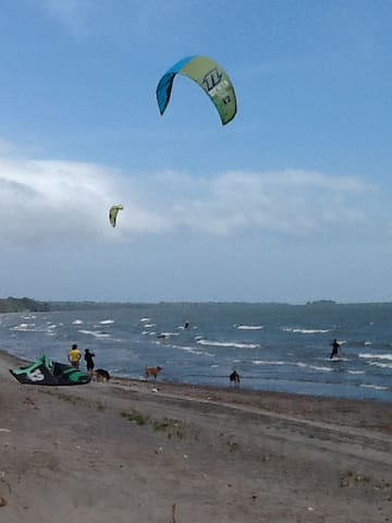 Santa Cruz Beach with kiteboarders in front of the Beach House